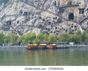 Longmen Grottoes World Heritage Site, The Boat Tour at The Longmen Caves along the Yi River near Luoyang in Luoyang City, Henan Province, China, 14th October 2018.