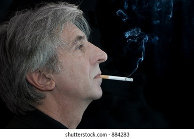 Long-nosed and grey-haired smoking senior.