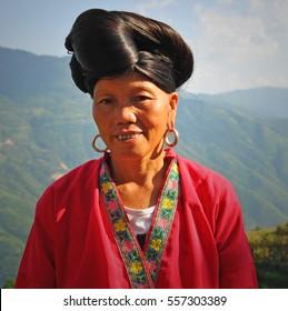 LONGSHENG PING AN, CHINA - AUGUST 20 2011: Portrait of a long hair woman of the Yao ethnic minority in the guangxi province.