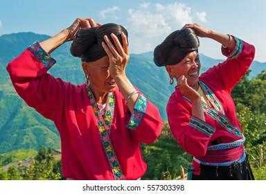 LONGSHENG PING AN, CHINA - AUGUST 20 2011: Long hair women of the Yao ethnic minority in the guangxi province.