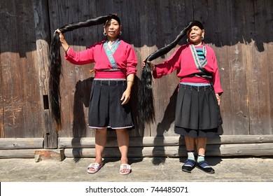 LONGSHENG PING AN, GUANGXI AUTONOMOUS REGION, CHINA – CIRCA JUNE 2016: Portrait of the long hair women from ethnic minority Yao in Guangxi autonomous region in China.