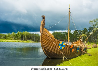 Longship - A Viking longboat sails to new shores for trading and companionship. Drakkar boat. Viking transport ship.
