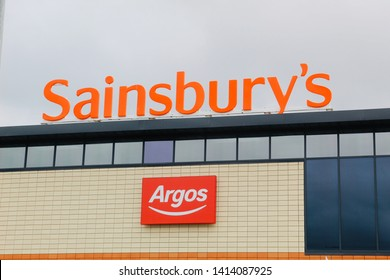 LONGSTONE, EDINBURGH, SCOTLAND - 02 June 2019 Sainsbury's and Argos Logos Outside Large Retail Building in the Longstone Area of Edinburgh