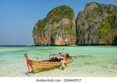 Longtail boat anchored at Maya Bay on Phi Phi Leh Island, Krabi Province, Thailand. It is part of Mu Ko Phi Phi National Park.