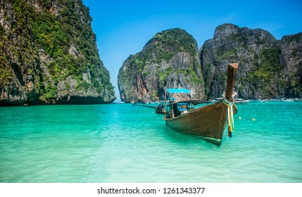 Long-tail boat floating in transparent water of Maya Bay beach, the paradise island.