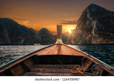 Longtail boat on Phi Phi Island in front of Maya Bay with Sunset