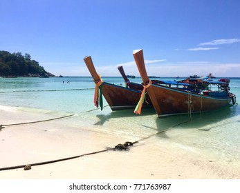 Longtail boat parked at the beach in Thailad