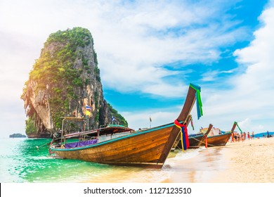Longtail boat parked on natural sea beach waiting travelers, Ao nang beach, Andaman sea, Krabi near Phuket, Water travel Thailand, Tourism beautiful destination Asia, Summer holiday vacation trip