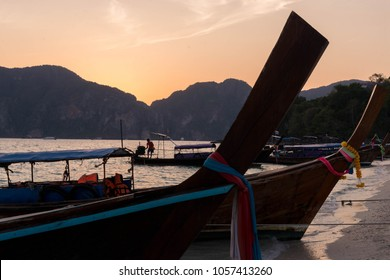 Longtail boat at sunset against the background of the mountains. Phi Phi Islands, Krabi, Thailand