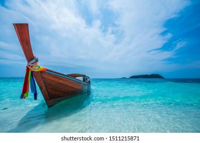 longtail boat and tropical beach, At Lipe island, Andaman Sea, Thailand