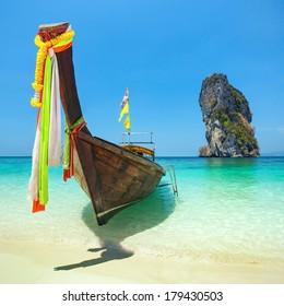 Longtail boat at the tropical beach of Poda island, Andaman sea, Thailand