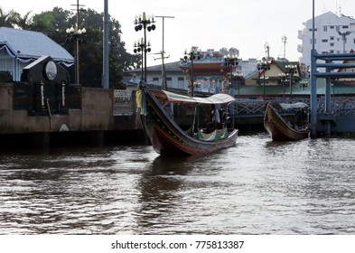 long-tail boat is very popular transportation for people          or tourists  traveling  and visiting place along the riverside in Thailand,colorful painting on  the boat