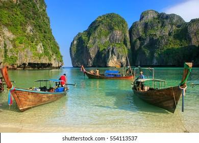 Longtail boats anchored at Maya Bay on Phi Phi Leh Island, Krabi Province, Thailand. It is part of Mu Ko Phi Phi National Park.