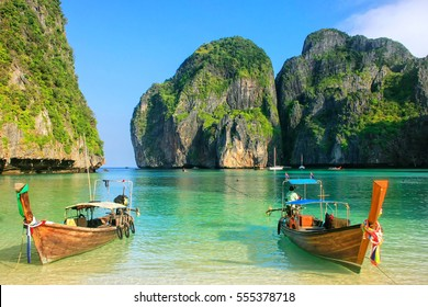 Longtail boats anchored at Maya Bay on Phi Phi Leh Island, Krabi Province, Thailand. It is part of Mu Ko Phi Phi National Park.