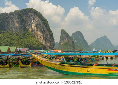 Long-tail boats docked at a floating city in Thailand