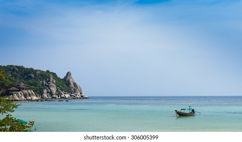 Longtail boats on an idyllic tropical shore