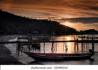 Longtail boats on seashore at sunset, Thailand