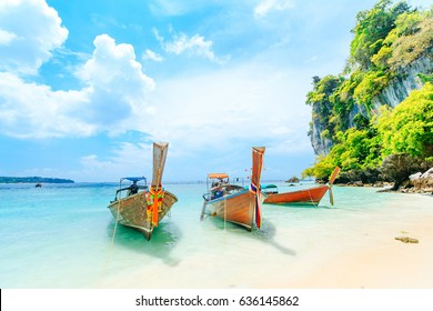 Longtale boat on the white beach at Phuket, Thailand. Phuket is a popular destination famous for its beaches.