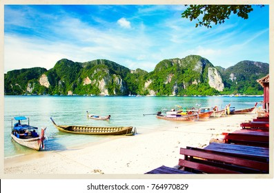 Longtale boats at the beautiful beach next to cafe. Thailand. Phi-Phi. Post card look.