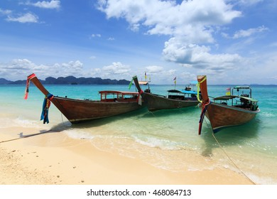 Longtale boats at the beautiful beach, Thailand long boats on Railay beach at Krabi Thailand, Traditional thai boats at the beach.