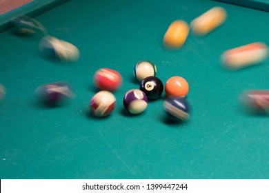 Longtime exposure of billiard balls being hit by queue and balls intentional movement