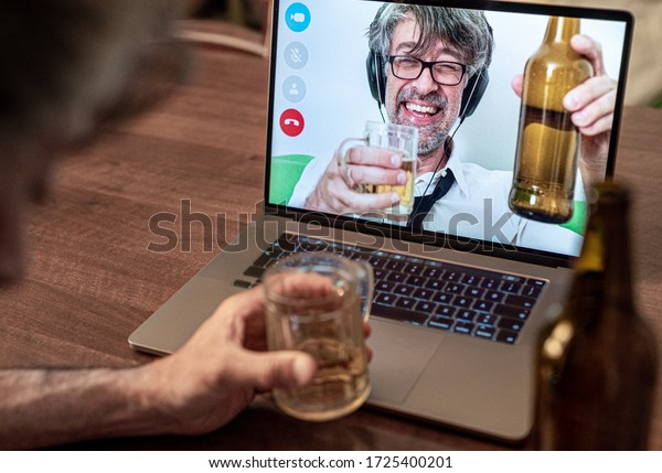 Long-time friends chat and drink beer on video call, work colleagues celebrate a long-distance success toasting with beer, getting drunk on a call