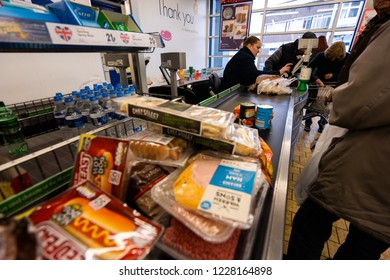 Longton, Stoke on Trent, Staffordshire - 12th November 2018 - A lidl till, checkout operator serving customers in store, fast and efficient