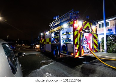 Longton, Stoke on Trent, Staffordshire - 16th February 2019 - Fire engines and firemen attend an emergency house fire on a quiet housing estate in the city caused by a fault washing machine wiring