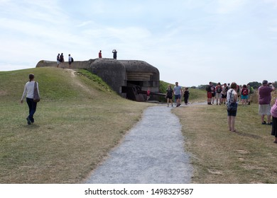LONGUES SUR MER, FRANCE - AUGUST 14: people visiting world war defence battery at longues sur mer on August 14, 2018