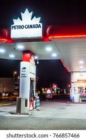 Longueuil, Canada _ December 1, 2017. Petro Canada Commerce and Gas Station Illuminated Late at Night