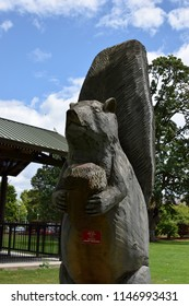 Longview, WA/USA - 7/2/18: Squirrel with acorn sculpture dedicated to Amos Peters, builder of the Nutty Narrows Bridge.