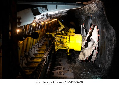 Long-wall Mining. Shearer, with two rotating cutting drums and movable hydraulic powered roof supports called shields in coal mine, Poland