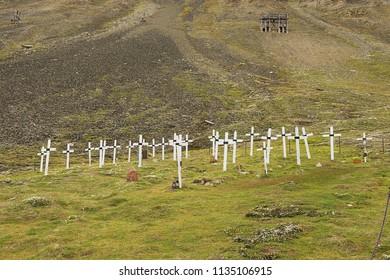 LONGYEAARBYEN, NORWAY - SEPTEMBER 01, 2011: White crosses at the old cemetery in permafrost ground in Longyearbyen, Norway.