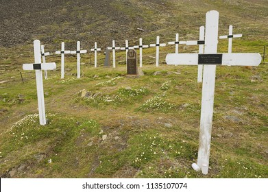 LONGYEAARBYEN, NORWAY - SEPTEMBER 01, 2011: White crosses at the old cemetery in permafrost ground in Longyearbyen, Norway.