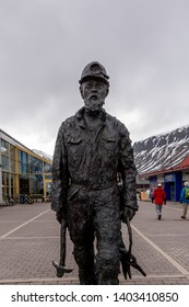 Longyearbyen, Norway 06 01 2018: Coal miner statue created by Tore Bjorn Skjlsvik in 1999. It is called The Miner and is located in Longyearbyen, Svalbard, Norway.