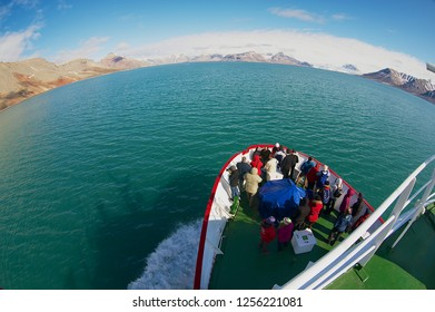 Longyearbyen, Norway - September 03, 2011: Unidentified tourists enjoy the arctic polar sea views from the cruise ship in Longyearbyen, Norway.