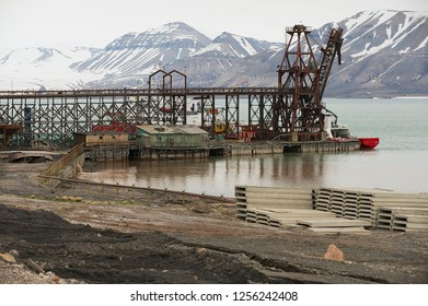 Longyearbyen, Norway - September 03, 2011: View to the pier of the abandoned Russian arctic settlement Pyramiden, Norway.