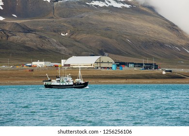Longyearbyen, Norway - September 03, 2011: Ship sails along the arctic shore of Longyearbyen in Longyearbyen, Norway.