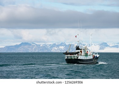 Longyearbyen, Norway - September 03, 2011: Ship sails along the shore of Longyearbyen in Longyearbyen, Norway.