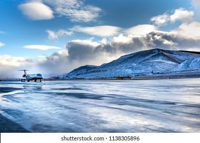 Longyearbyen, Spitsbergen, Norway - September 17, 2014, Arctic airport, airplane is landing  on a icy runway