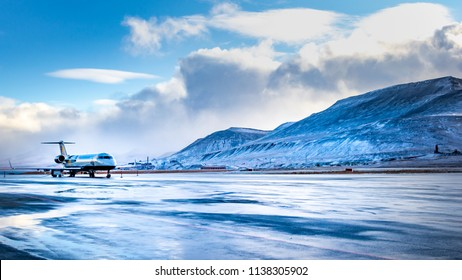 Longyearbyen, Spitsbergen, Norway - September 17, 2014, Arctic airport, airplane is landing  on a icy runway