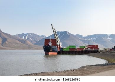 Longyearbyen, Svalbard - August 13th, 2018: A ship docked at the port of Longyearbyen in the Longyearelva River, Svalbard.