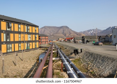 Longyearbyen, Svalbard, Norway - August 13th, 2018: Pipelines along a road in Longyearbyen, the largest settlement and administrative center of Svalbard.
