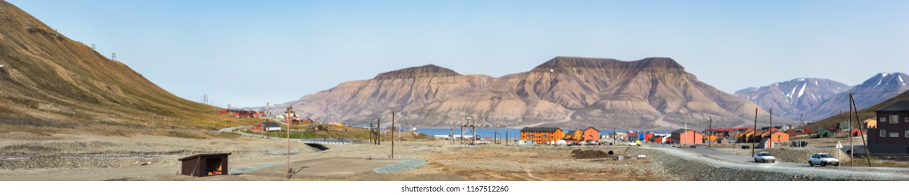 Longyearbyen, Svalbard, Norway - August 13th, 2018: Panorama of the center of Longyearbyen with a large mountain behind the Longyearelva River in the background.