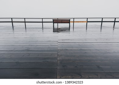 Lonley Bench at Barentsburg Harbour on a cloudy Day, Russian territory, Svalbard, Norway