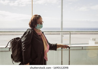 lonley woman at the airport stuck at the country and cant fly back home