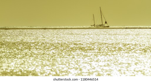 Lonley yacht at the horizon