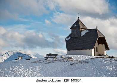 A lonly church on the top of a mountain