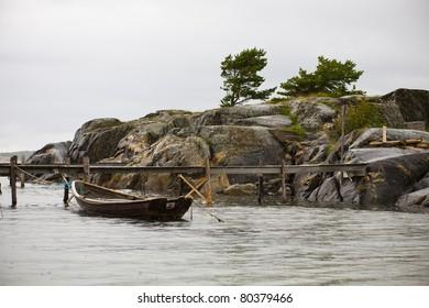 Lonly wooden boat in rain weather
