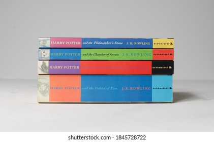 lonond, uk, 05/05/2020 A collection of harry potter books, the philosophers stone, the chamber of secrets, prisoner of azkaban and the goblet of fire, on a white rustic background. Childhood books.